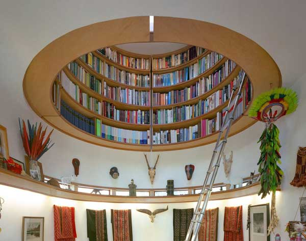Wade Davis Writing Studio By Travis Price Architects 2 Round Bookcase Hovering Above Davis Writing Studio